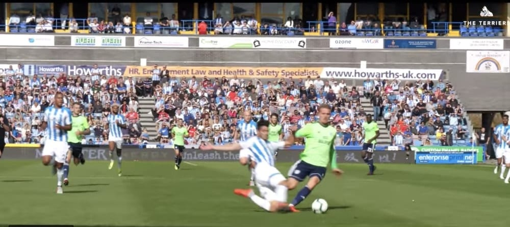 Slide tackle during the goalless draw between Huddersfield and Cardiff City