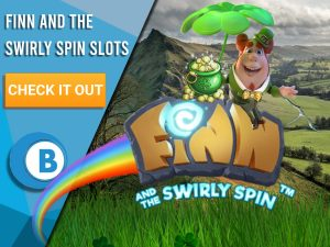 """Hill as background, with clover grass, pot of gold, rainbow and Finn and the Swirly Spin logo in the centre. Blue/white square can be seen on the left with text """"Finn and the Swirly Spin Slots"""", a CTA beneath and a BoomtownBingo logo below."""